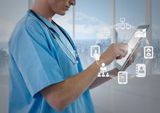 Male nurse using digital tablet with app icon interface screen Royalty Free Stock Photos
