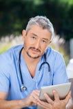 Male Nurse Using Digital Tablet At Nursing Home Stock Photography