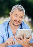 Male Nurse Using Tablet Computer Stock Images