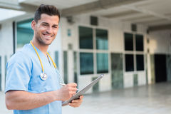 Male nurse vet with stethoscope  and tablet Royalty Free Stock Photography