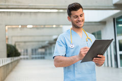 Male nurse vet with stethoscope  and tablet Stock Photo