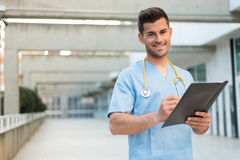 Male nurse vet with stethoscope  and tablet Royalty Free Stock Photo