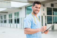 Male nurse vet with stethoscope  and tablet Stock Image