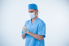 Male nurse wearing surgical mask and gloves Stock Photography