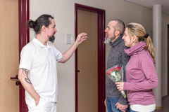 Male nuse gives informations. To two visitors in a hospital Stock Image