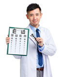 Male oculist holding eye chart and glasses Stock Images