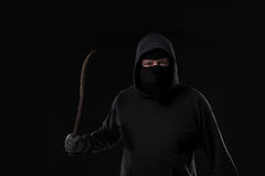 Male offender masked with a scrap. On black background at the studio Royalty Free Stock Image