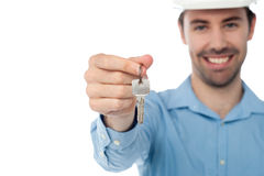 Male offering you office key Stock Photography
