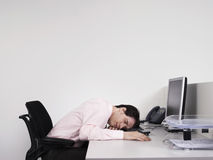 Male Office Worker Asleep At Desk Royalty Free Stock Photography