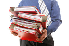 Male office worker carrying a stack of files Stock Photography