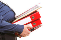 Male office worker carrying a stack of files Stock Photo