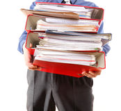Male office worker carrying a stack of files Royalty Free Stock Image