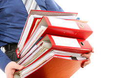 Male office worker carrying a stack of files Stock Photos