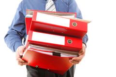 Male office worker carrying a stack of files. Man holding stack of folders. Pile with old documents and bills. Isolated on white background stock photo