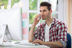 Male office worker front computer Royalty Free Stock Photos