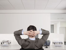 Male Office Worker Relaxing At Desk Royalty Free Stock Photos