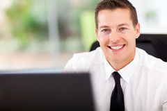 Male office worker. Smiling male office worker looking at the camera Stock Photo