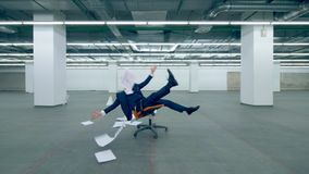 Happy office worker throws paper in the air while sitting in a chair. Male office worker throws paper in the air while sitting in a chair. 4K stock footage