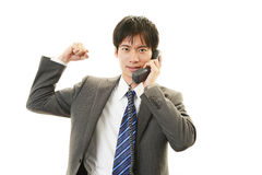 The male office worker who poses happily Royalty Free Stock Images