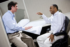 Male office workers conversing Royalty Free Stock Photography