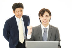 The male office workers who poses happily Stock Image