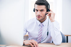 Male operator sitting at his workplace in office Stock Photos
