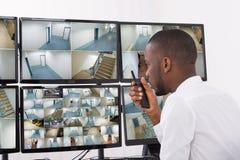 Male Operator Talking On Walkie-Talkie Stock Photography
