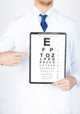 Male ophthalmologist with eye chart Stock Images