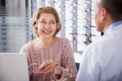 Male ophthalmologist in optics store Royalty Free Stock Image