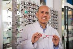 Male ophthalmologist standing near eye chart Stock Image
