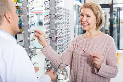 Male optician consulting adult female customer Stock Photography