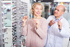Male optician offering glasses frames Royalty Free Stock Images