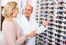 Male optician offering glasses frames Royalty Free Stock Photo