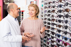 Male optician offering glasses frames Stock Images