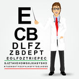 Male optician pointing to snellen chart Stock Images