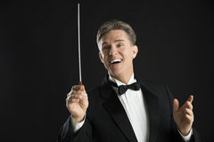 Male Orchestra Conductor Looking Away While Directing Royalty Free Stock Images