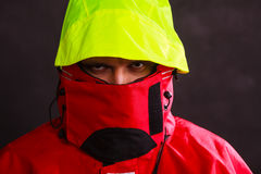 Male outdoorsman with covered face Stock Images