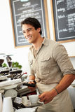 Male Owner Of Coffee Shop. Smiling stock photos