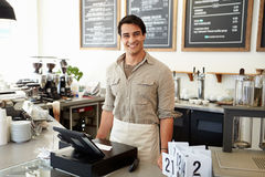 Male Owner Of Coffee Shop. Smiling to camera Royalty Free Stock Photo