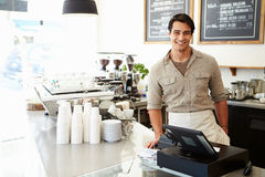 Male Owner Of Coffee Shop. Smiling To Camera royalty free stock images