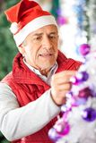Male Owner Decorating Christmas Tree At Store Royalty Free Stock Photos
