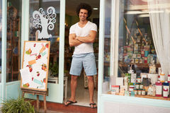 Male Owner Of Delicatessen Standing Outside Shop Royalty Free Stock Photo