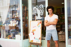 Male Owner Of Delicatessen Standing Outside Shop Stock Photos
