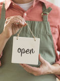 Male Owner Holding Open Sign Royalty Free Stock Images