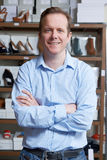 Male Owner Of Shoe Store. Portrait Of Male Owner Of Shoe Store Stock Photos