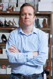 Male Owner Of Shoe Store. Portrait Of Male Owner Of Shoe Store Royalty Free Stock Photos
