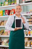Male Owner Showing Digital Tablet In Store Royalty Free Stock Photography
