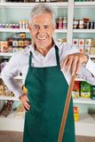Male Owner With Stick Standing In Store Royalty Free Stock Photo