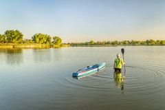 Male paddler with stand up paddleboard royalty free stock images