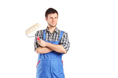 Male painter holding a paint roller Stock Images